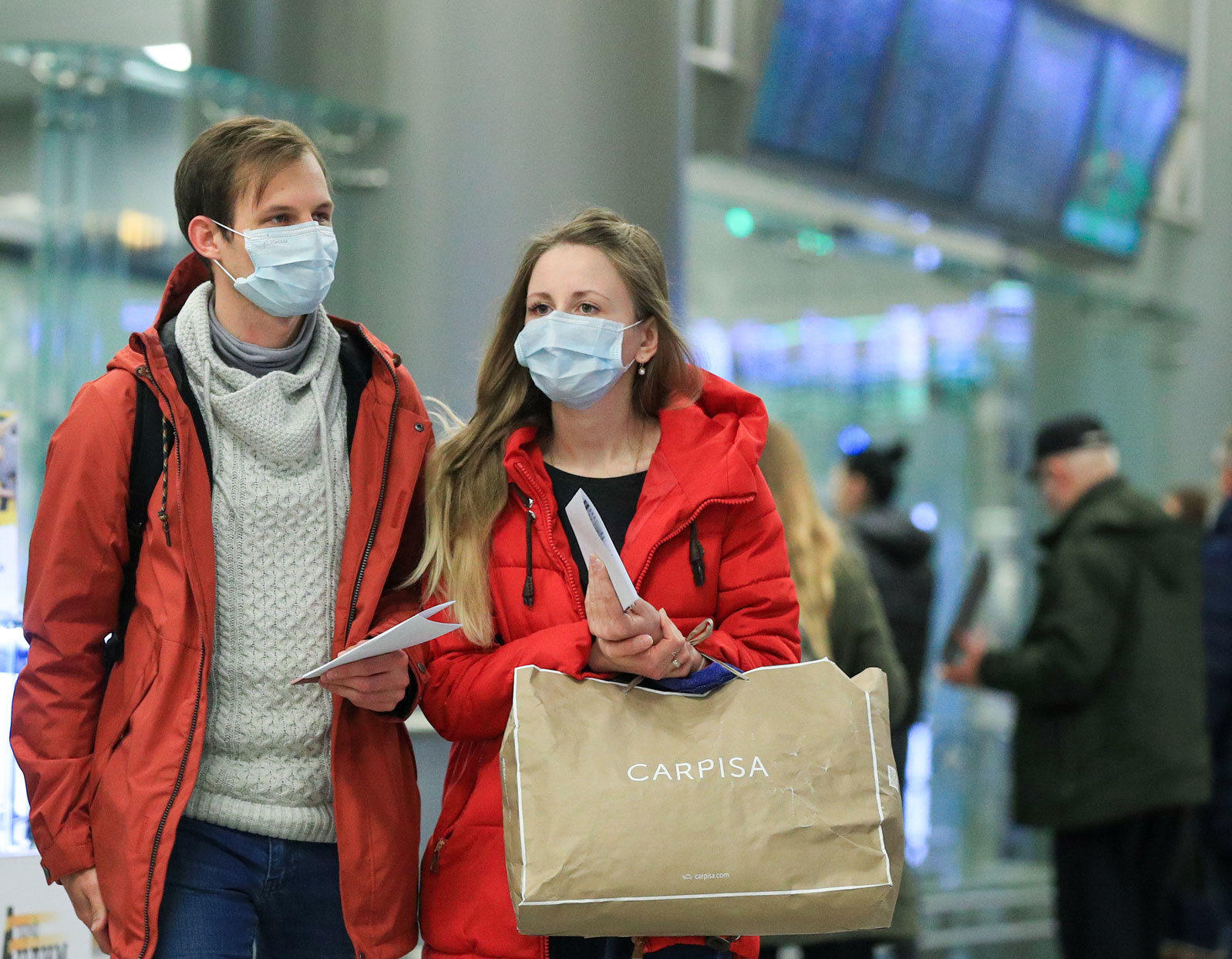 Shoppers wearing surgical masks