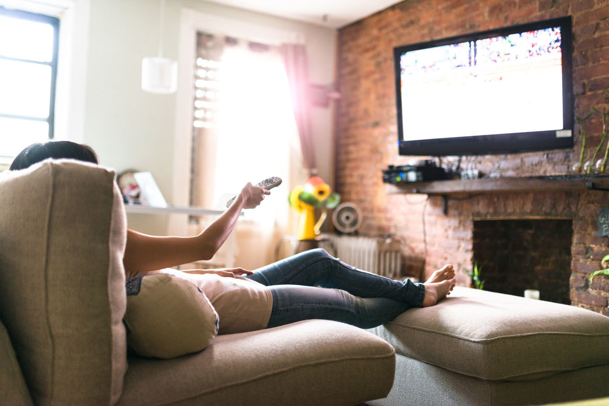 Woman watching TV from couch