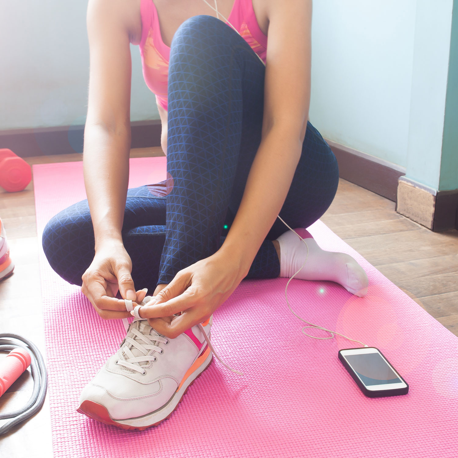 Woman preparing to exercise at home