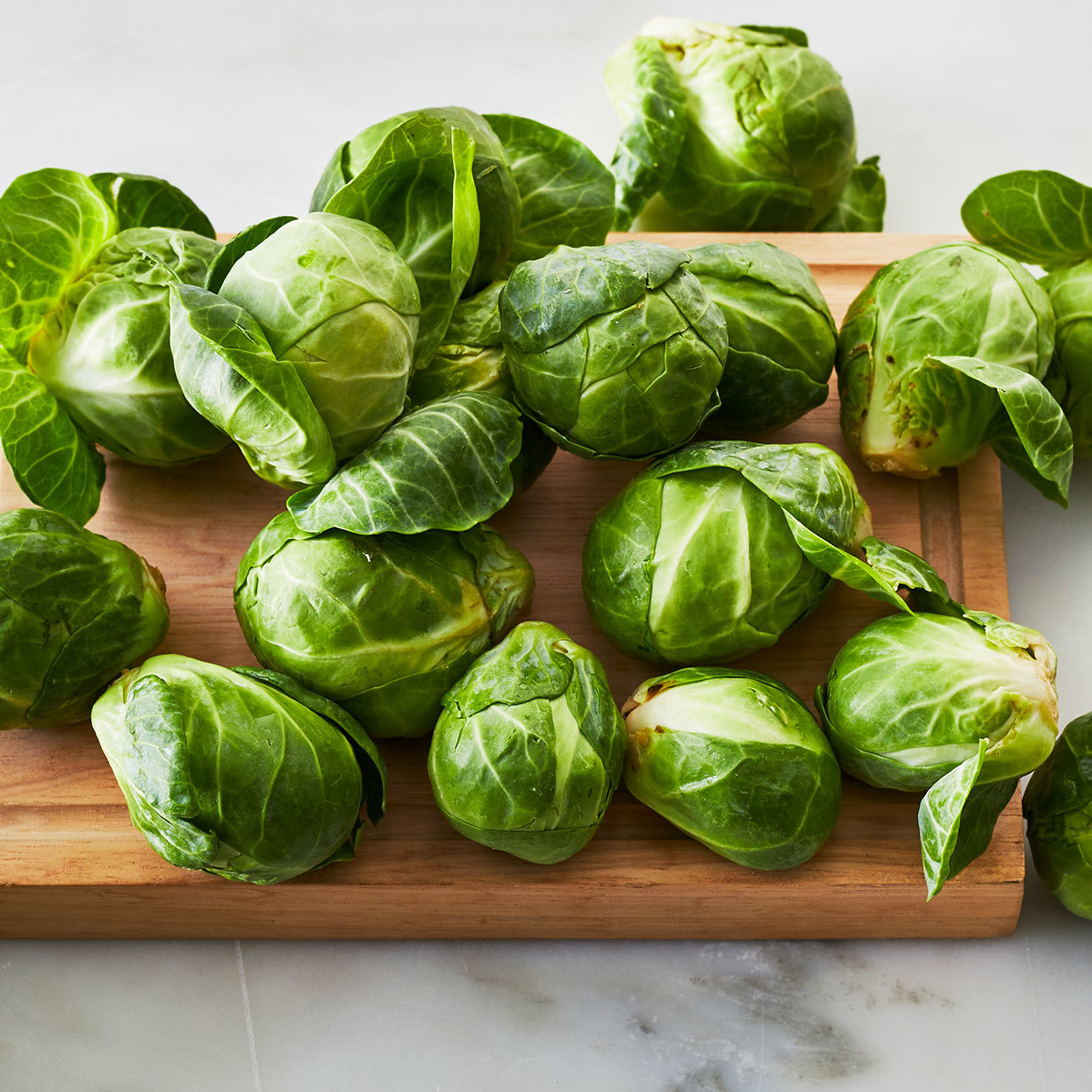 raw brussels sprouts on a cutting board