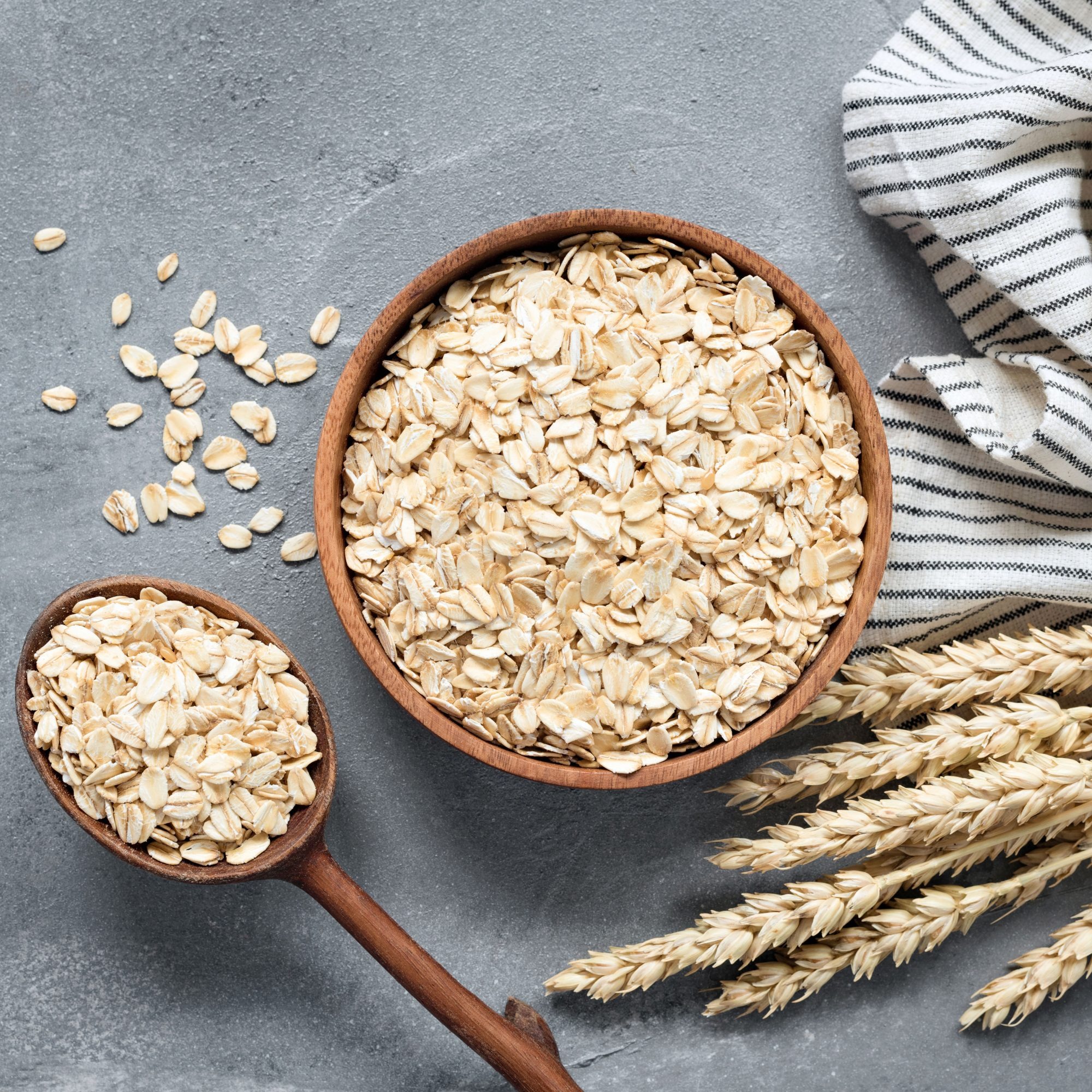 Bowl and spoon full of raw oats