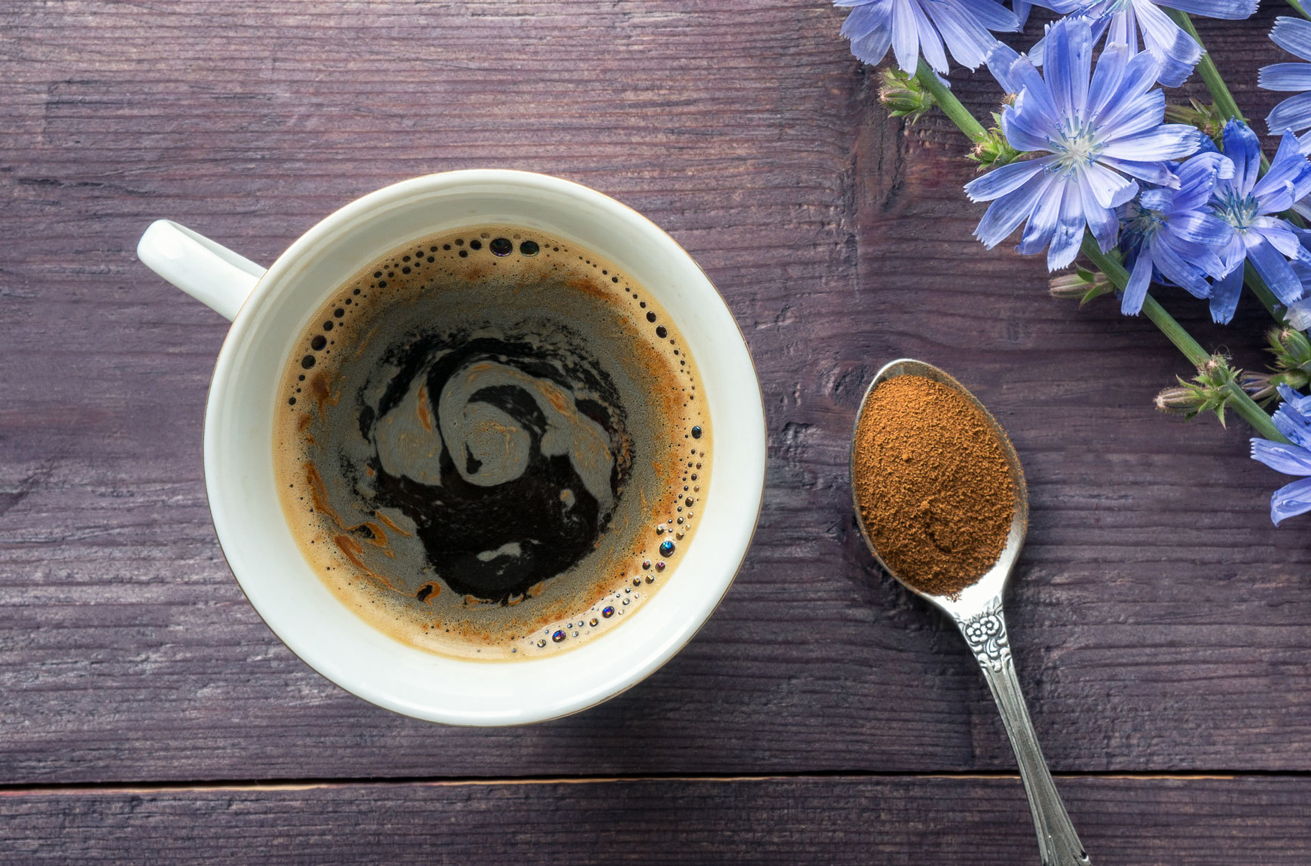 chicory coffee in a white mug on wooden background