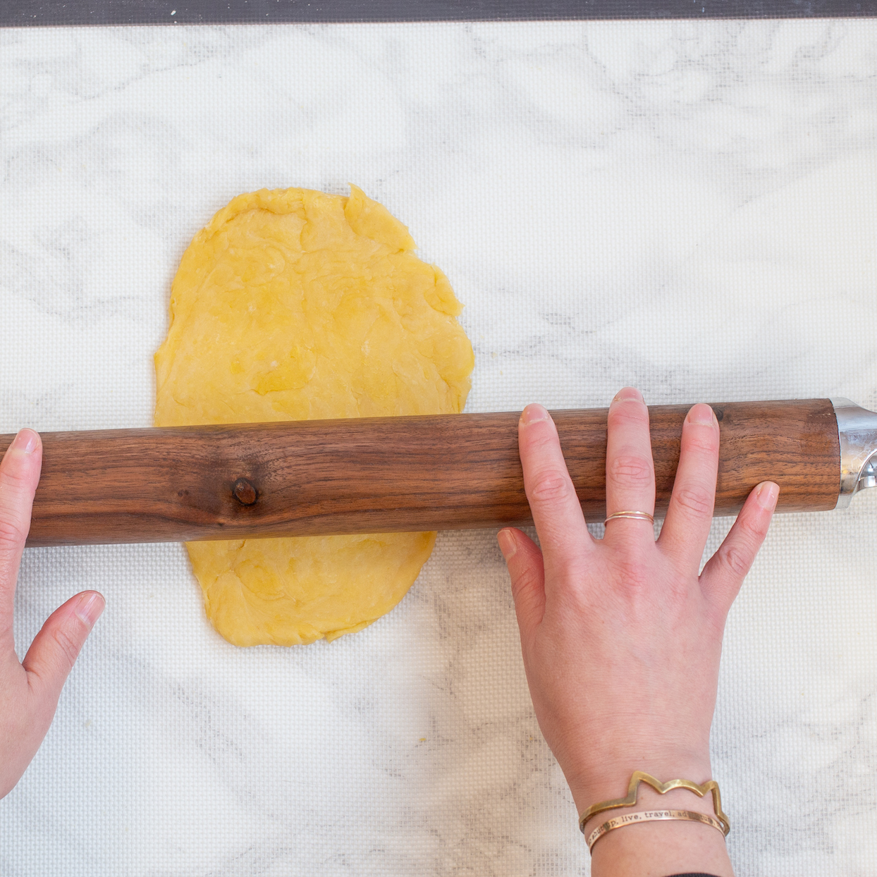 rolling out pasta dough with rolling pin