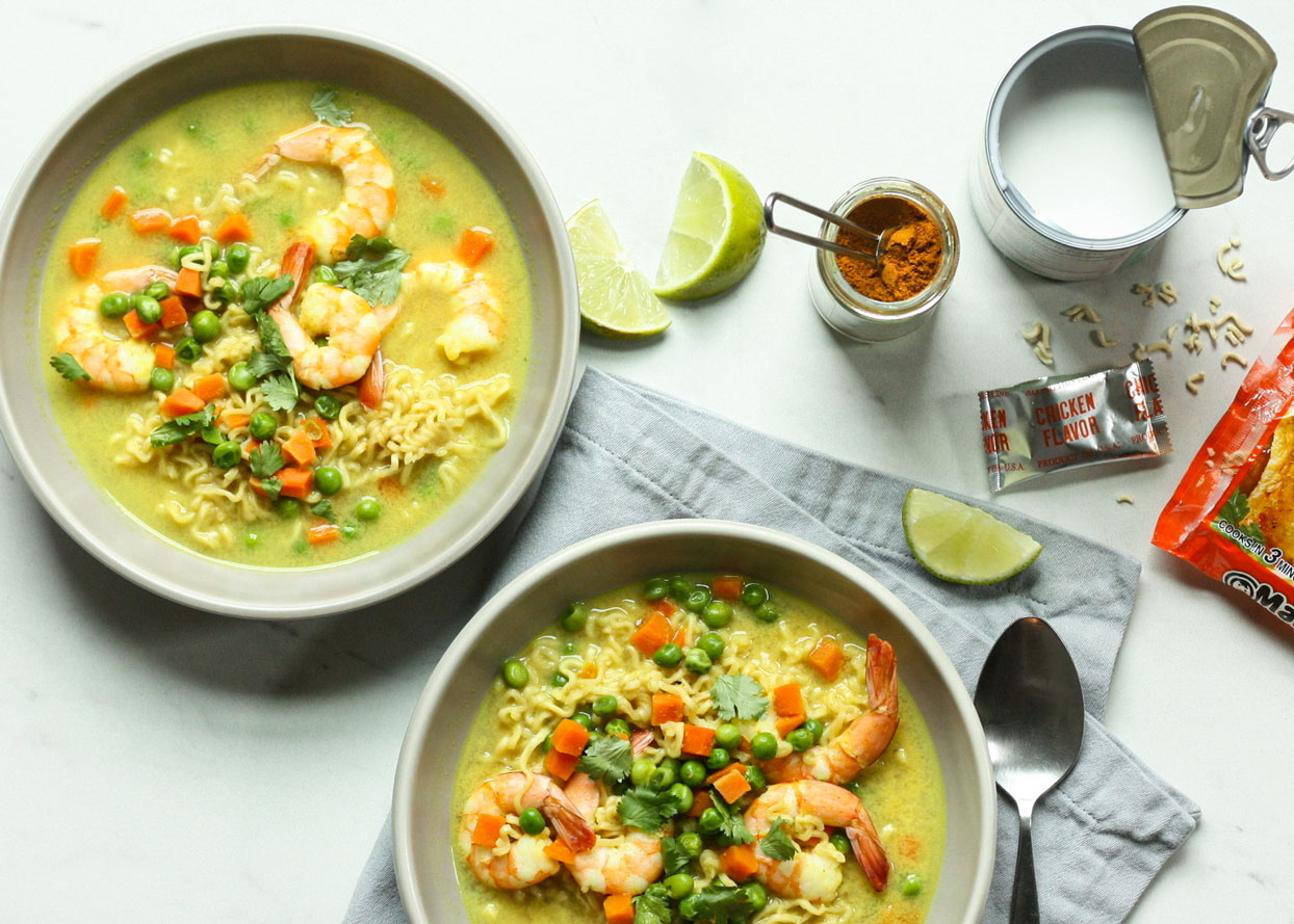 coconut shrimp ramen in bowls with lime wedges