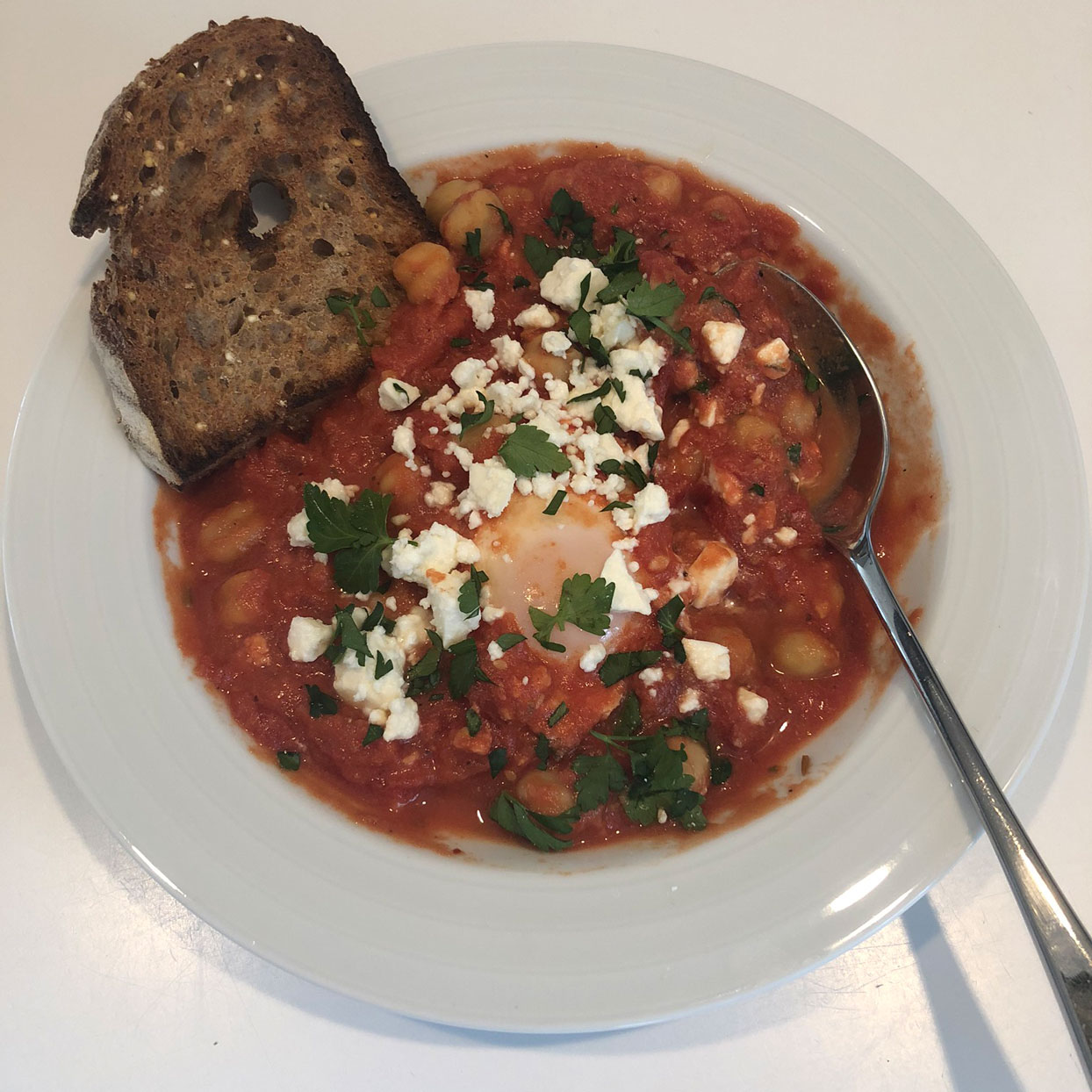 chickpea, tomato, egg dinner with feta and toast
