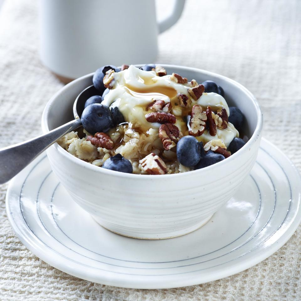 grain bowl with berries, yogurt and honey