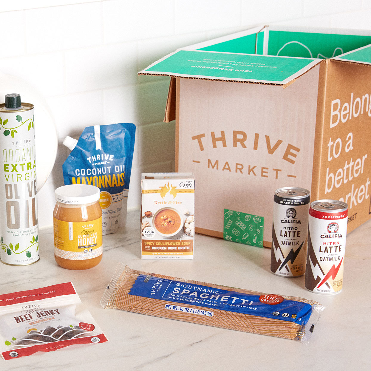 a box from Thrive Market with olive oil, coffee drinks and other products