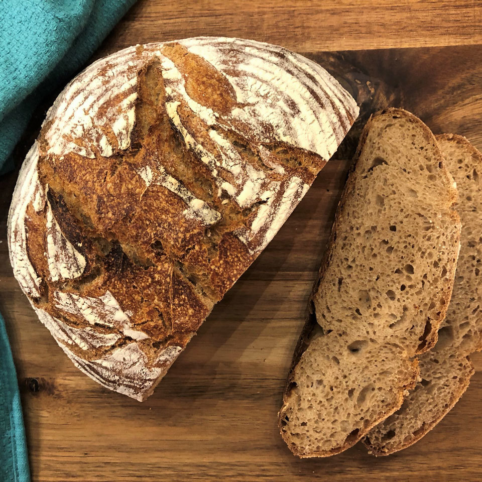 photo of whole-wheat sourdough bread on cutting board