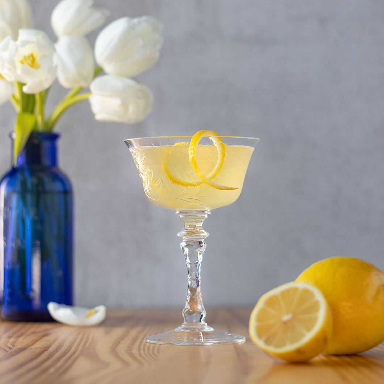 bees knees gin cocktail with lemon