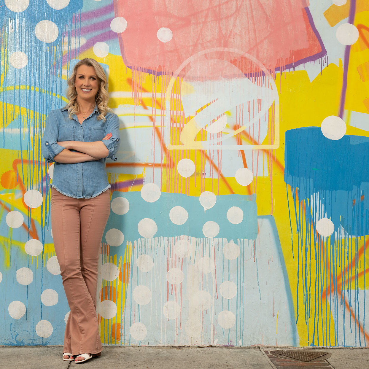 woman infront of colorful wall