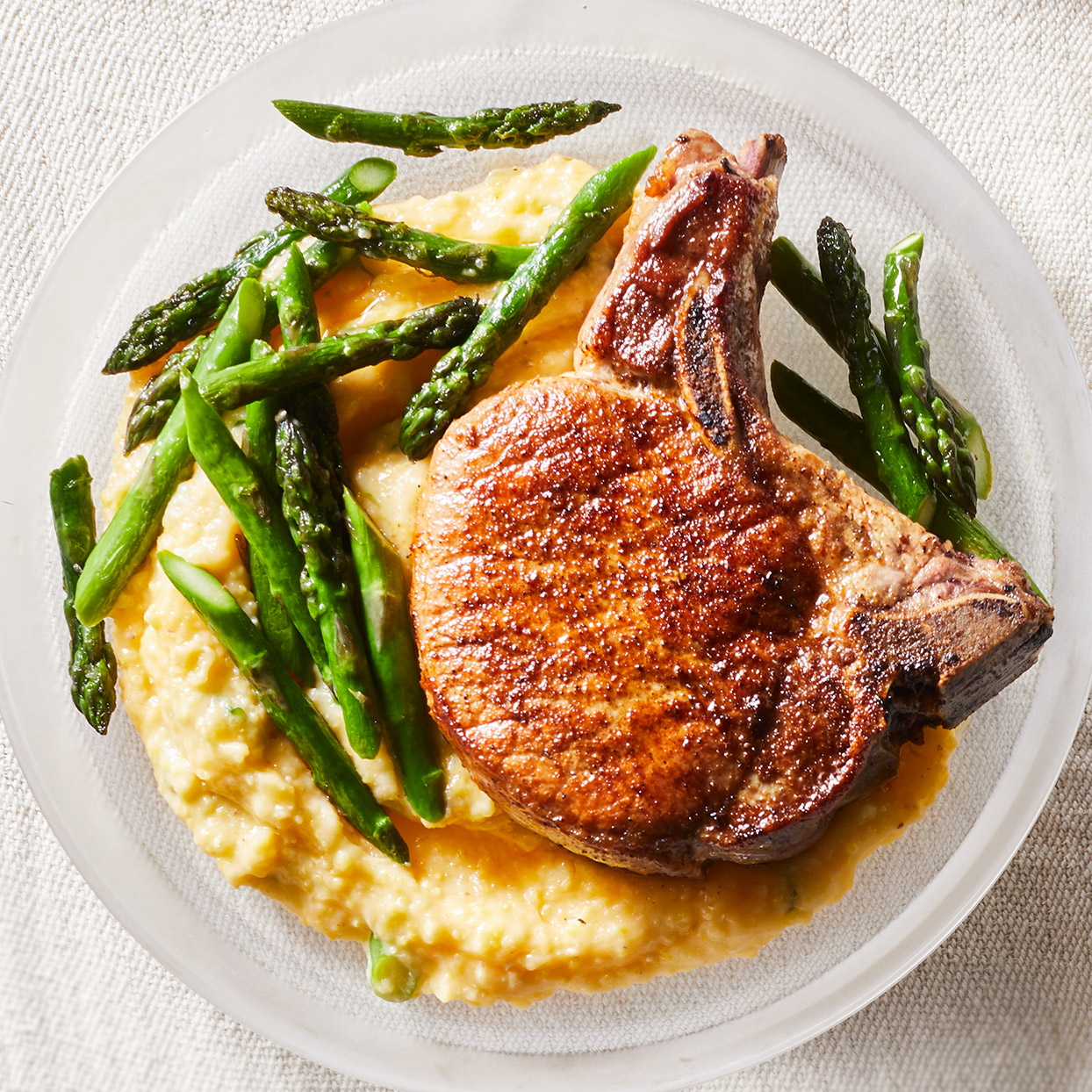 Cajun Skillet Pork Chops with Asparagus & Cheesy Polenta
