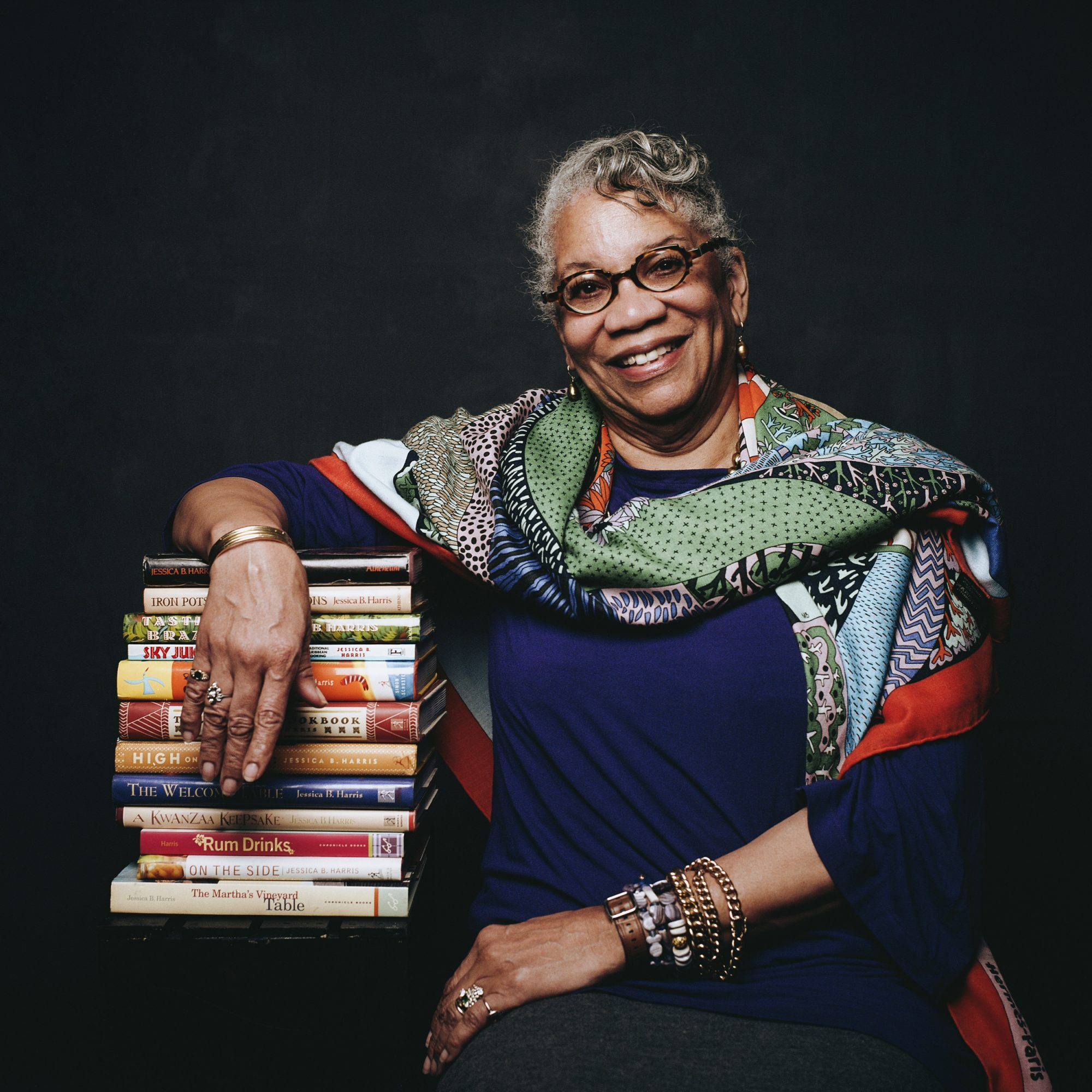 Portrait of Jessica B. Harris with a stack of books