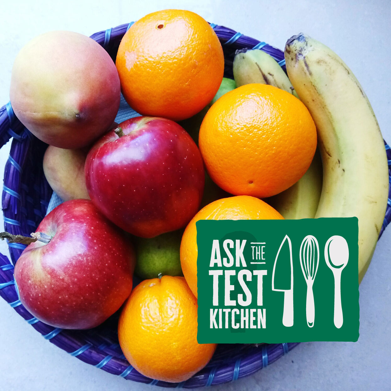 bowl of fruit with Ask the Test Kitchen logo