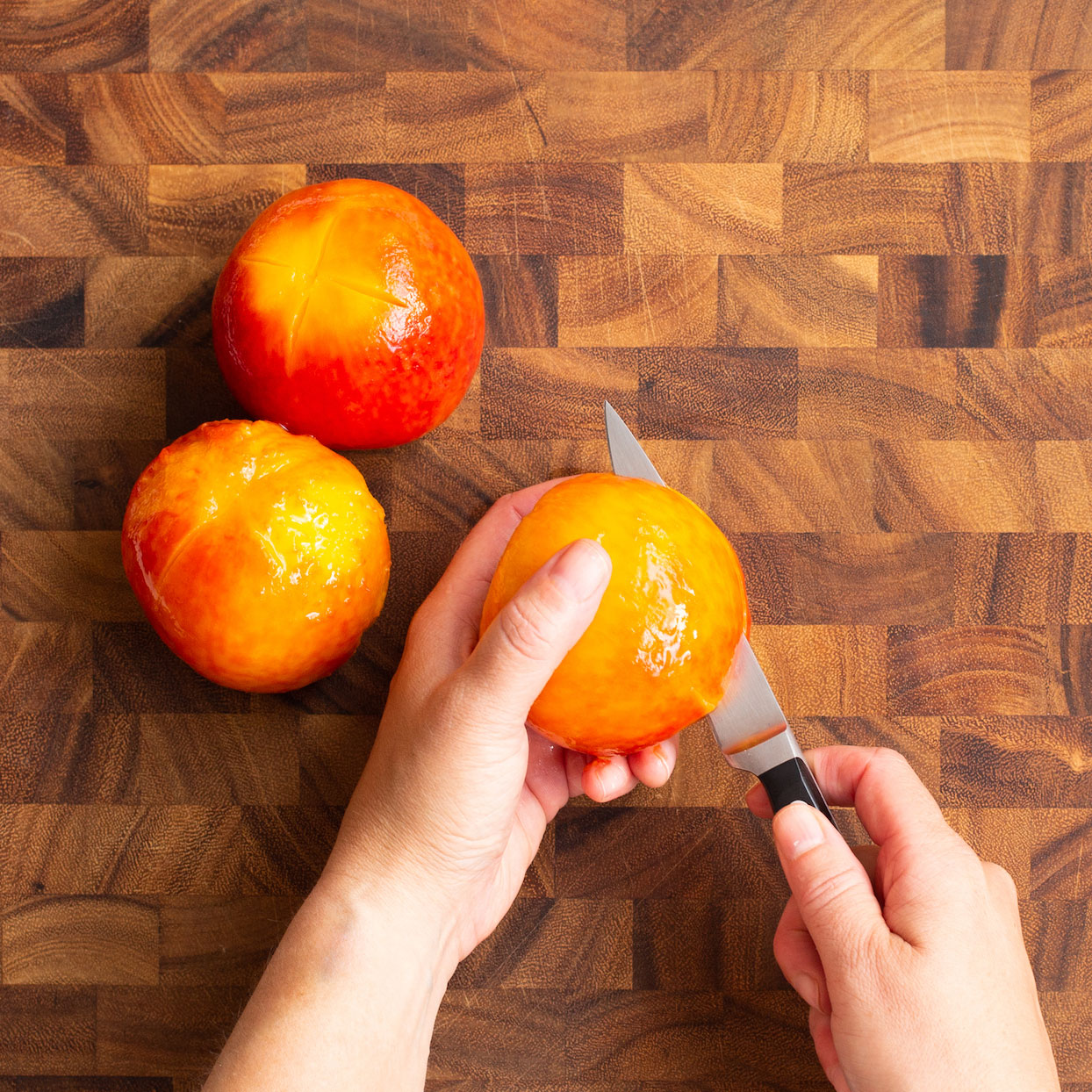 halving peeled peaches with paring knife