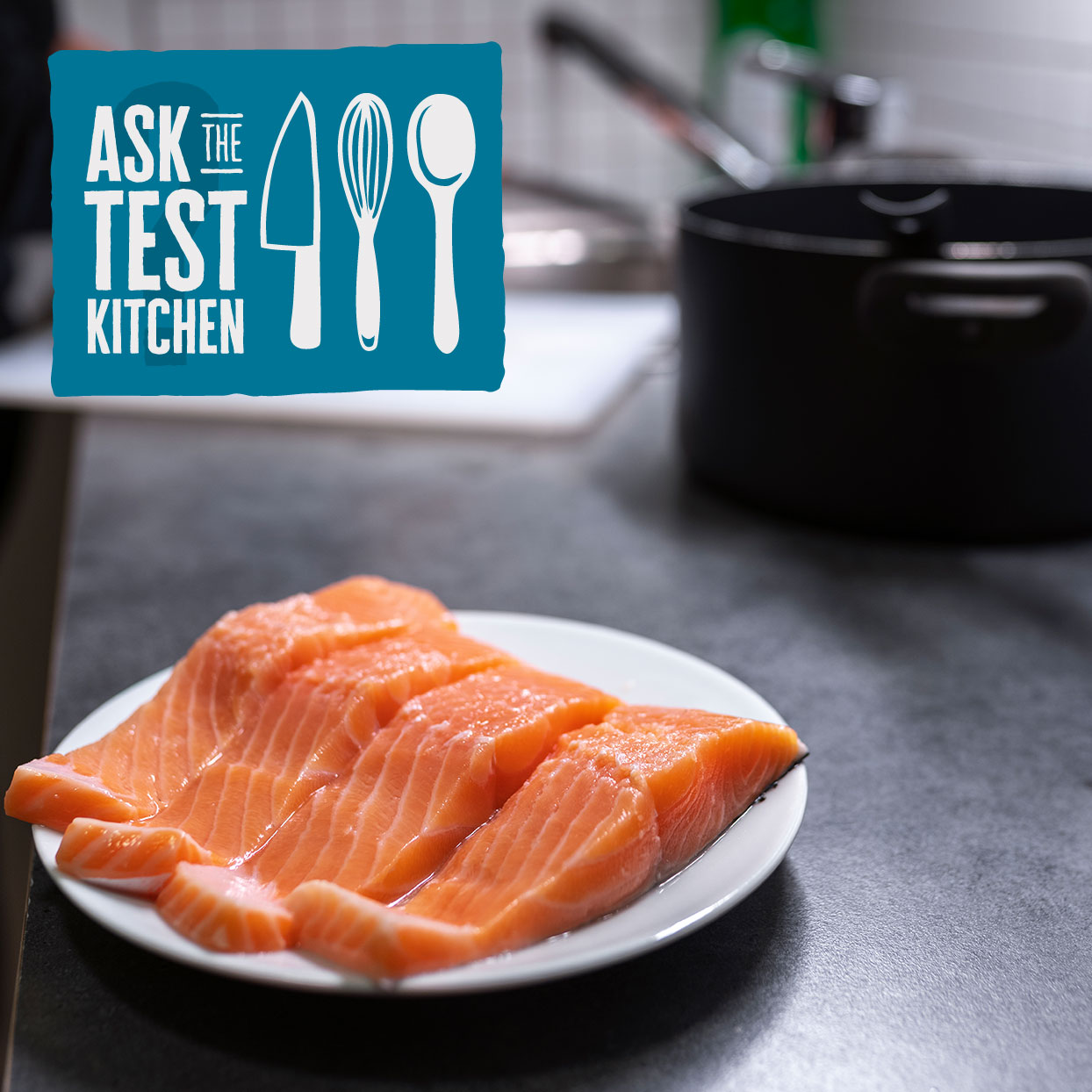 salmon steaks on a counter with ask the test kitchen logo