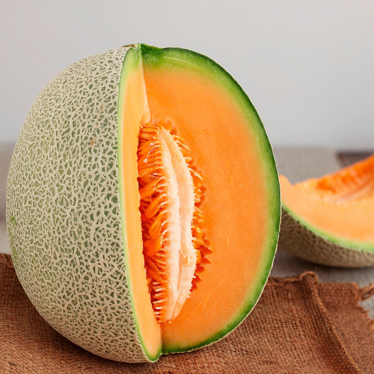 a cantaloupe with a slice taken out