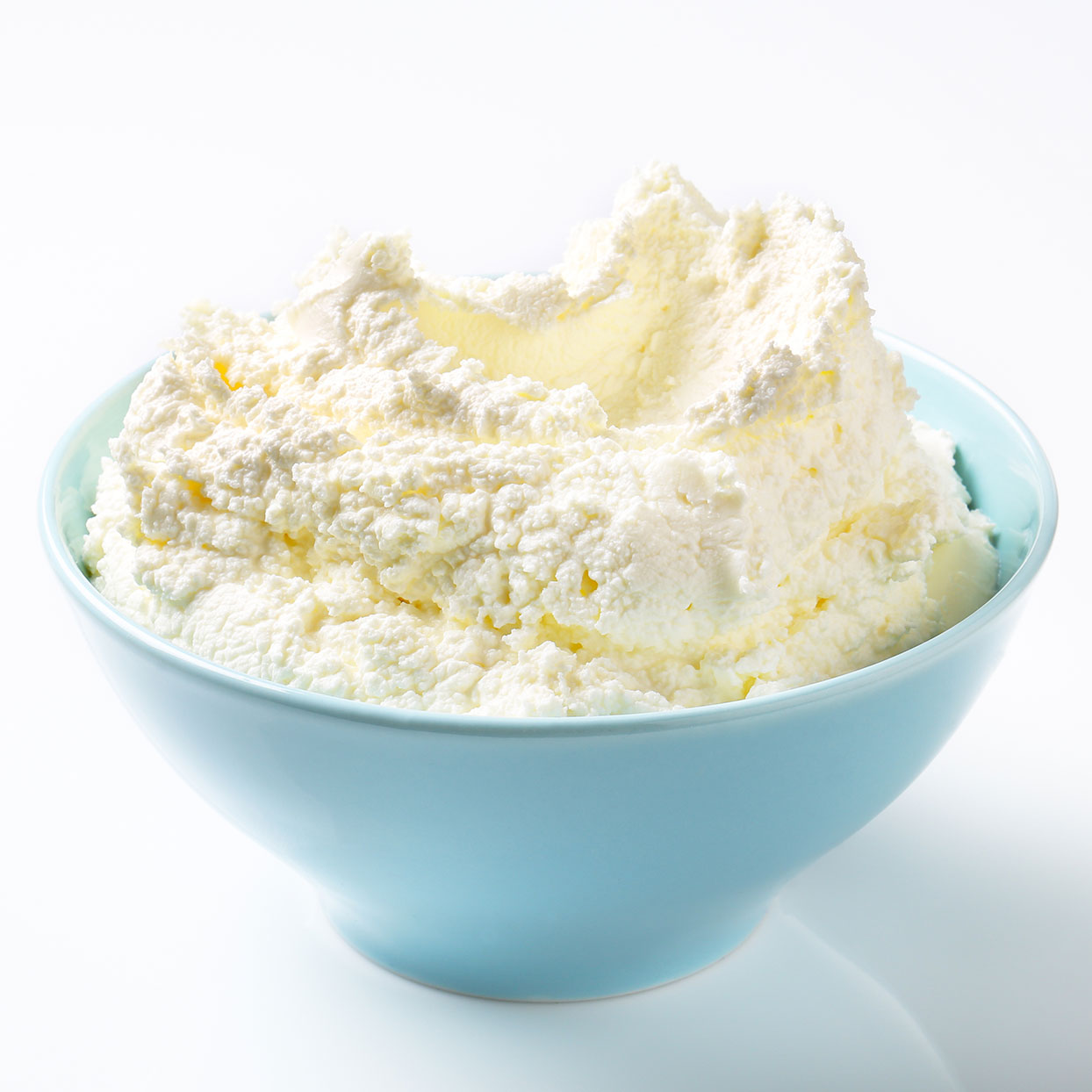 a blue bowl with cream cheese