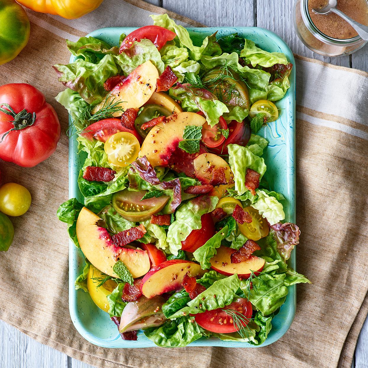 peach salad on plate with tomatoes
