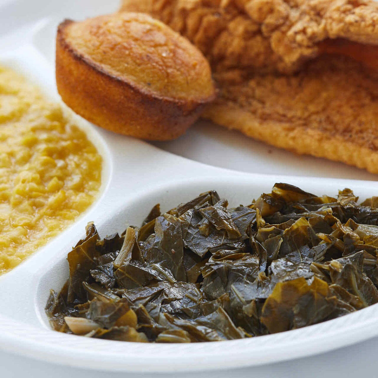 collard greens with ham hocks in a serving platter