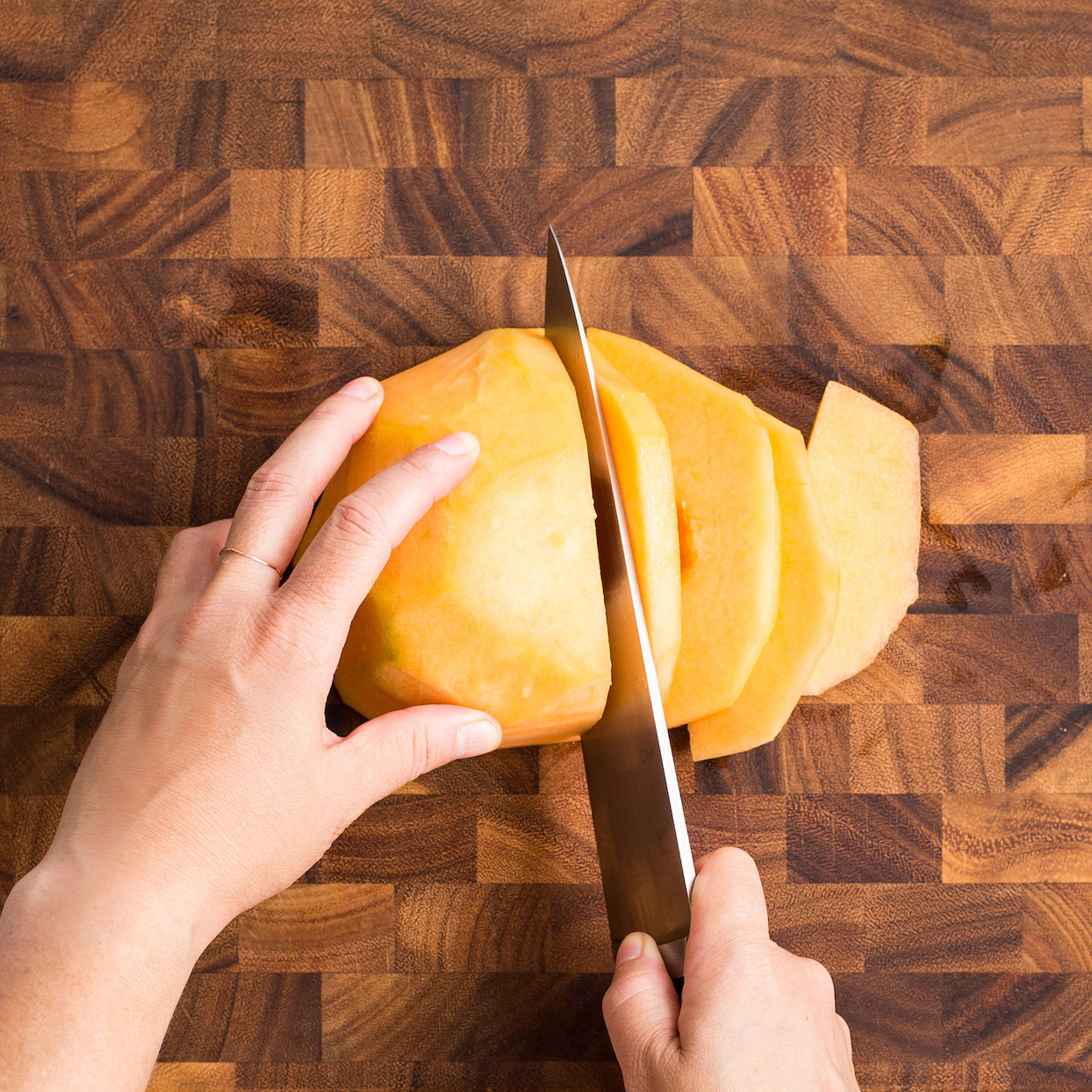 Cutting cantaloupe into wedges