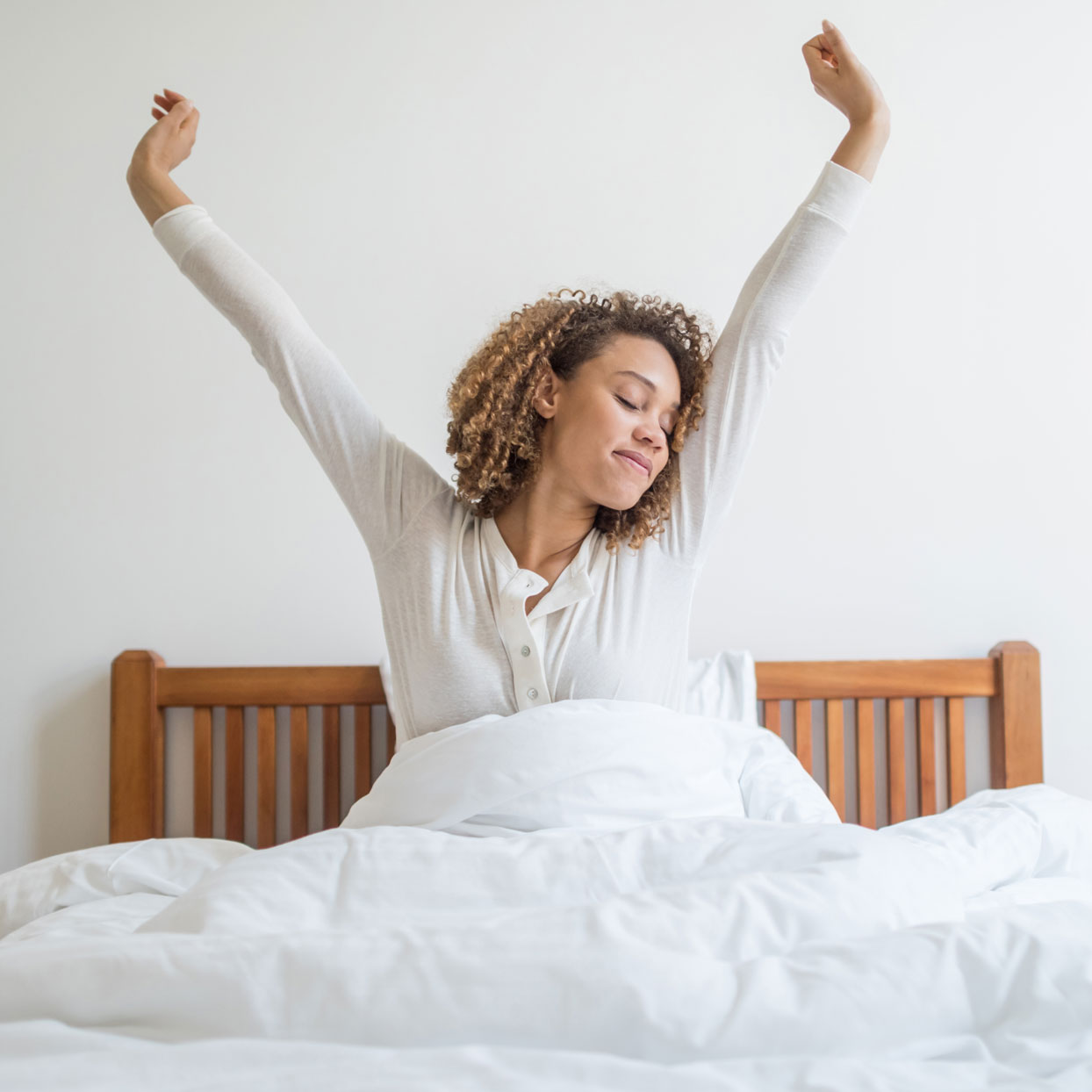 woman stretching after sleeping