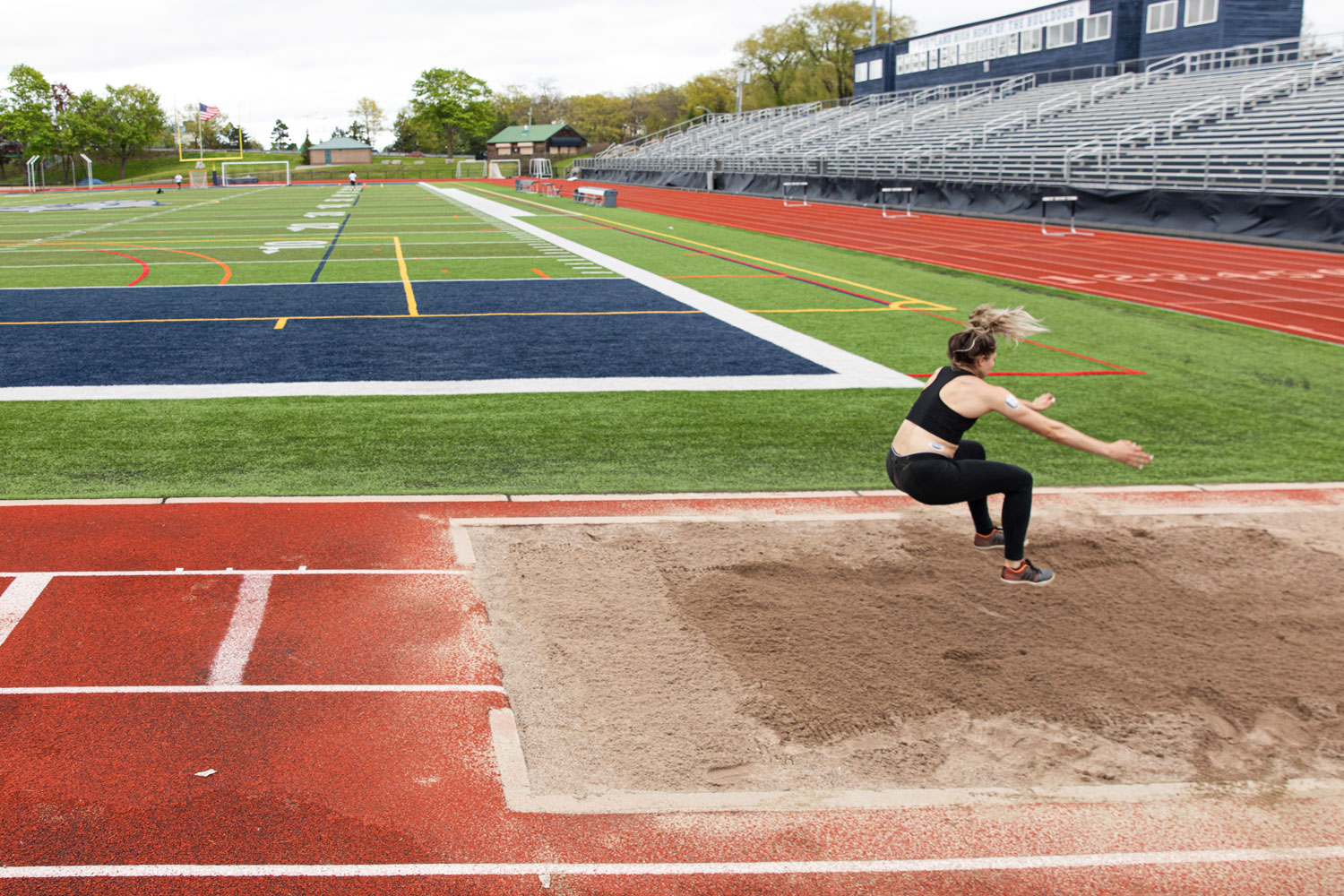Kate Hall performing a long jump