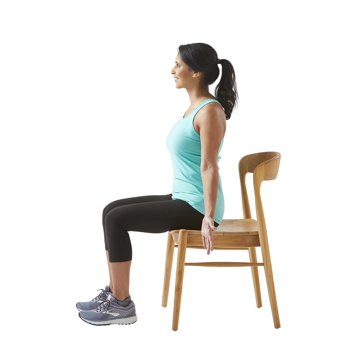 woman stretching in chair