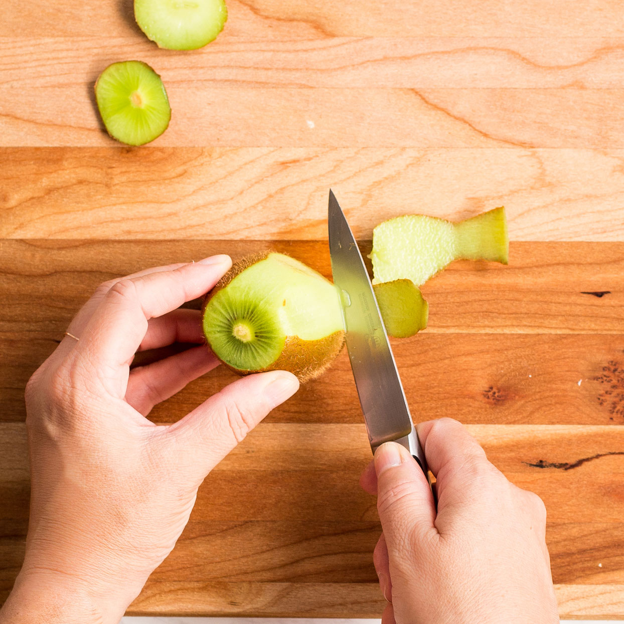 peeling kiwi with a paring knife