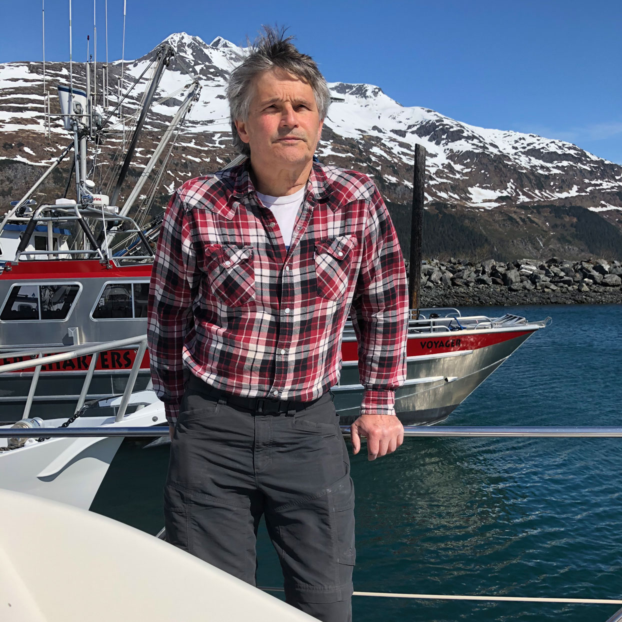 man infront of body of water on boat