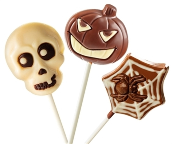 Halloween themed chocolate lollipops on a white background