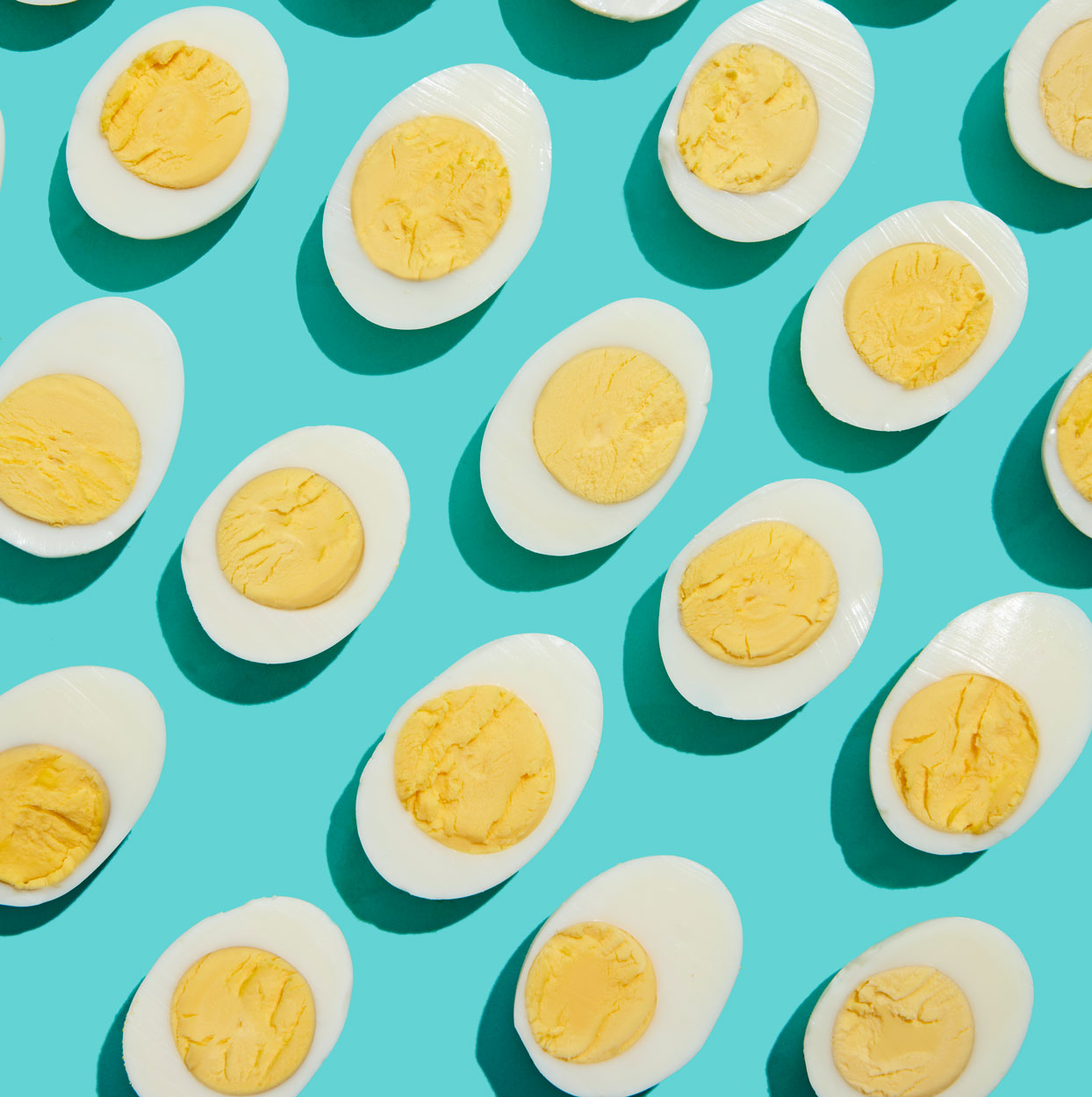 hard boiled eggs shot overhead on light blue background