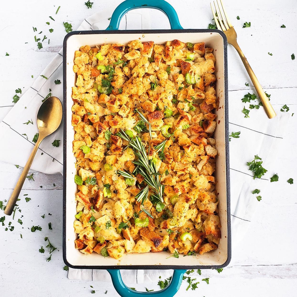 simple herb stuffing recipe in a baking dish on a white tablecloth