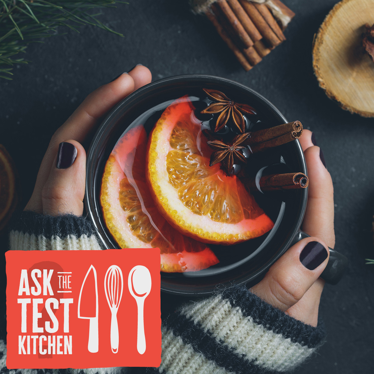 hot drink in hands with dark nail polish and an Ask the Test Kitchen logo