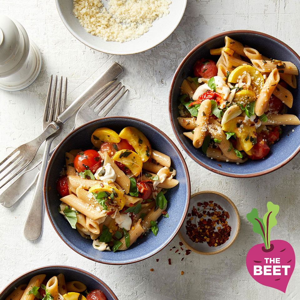 cherry tomato pasta shot overhead in blue bowls with the beet logo