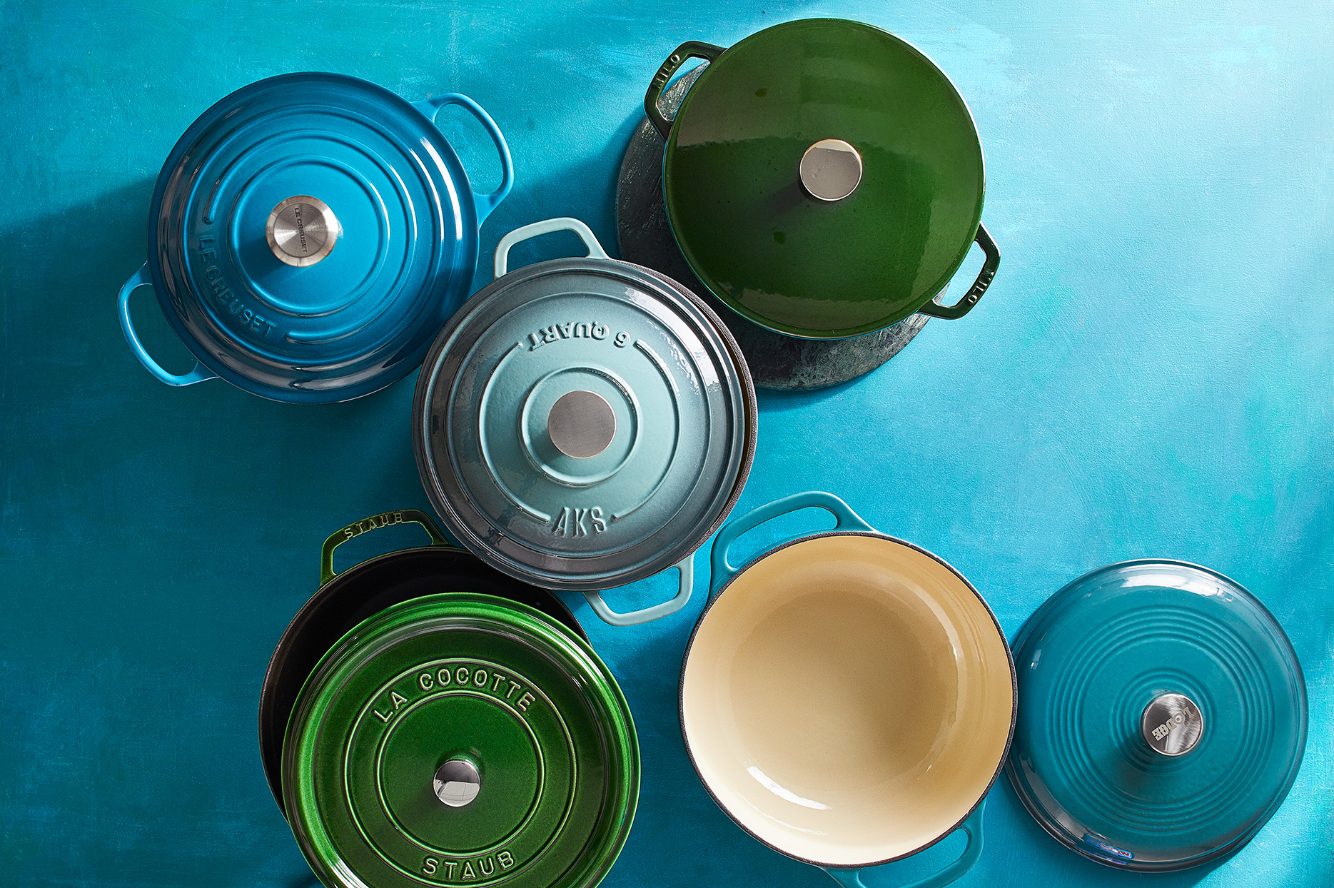 Blue and green Dutch ovens