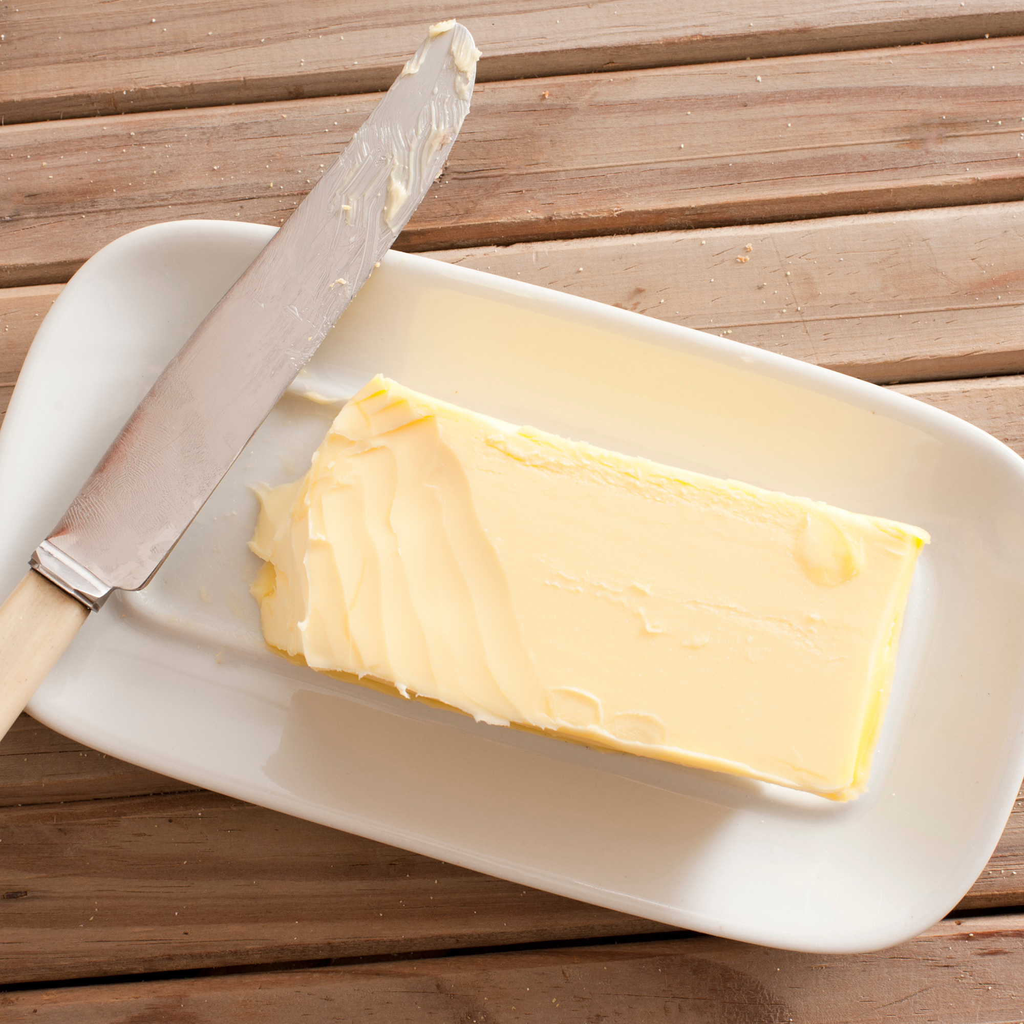 a dish of butter with a knife