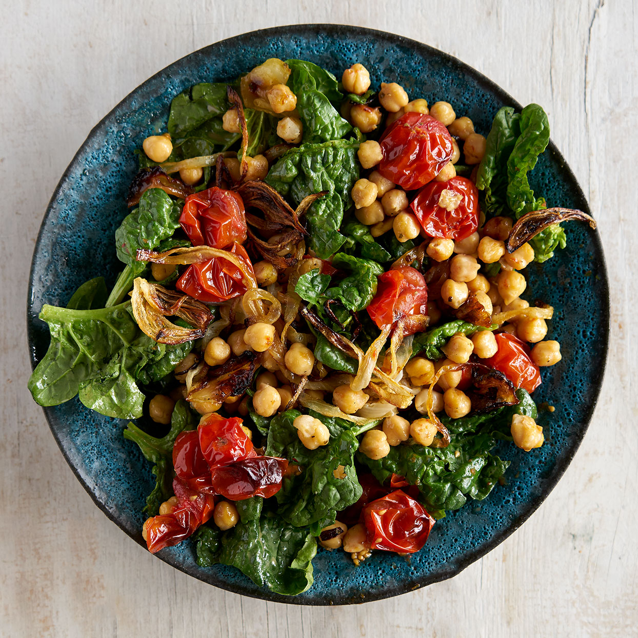 Warm Spinach Salad with Chickpeas & Roasted Tomatoes