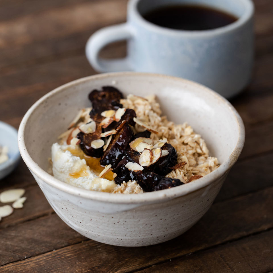 bowl of oatmeal with figs on top