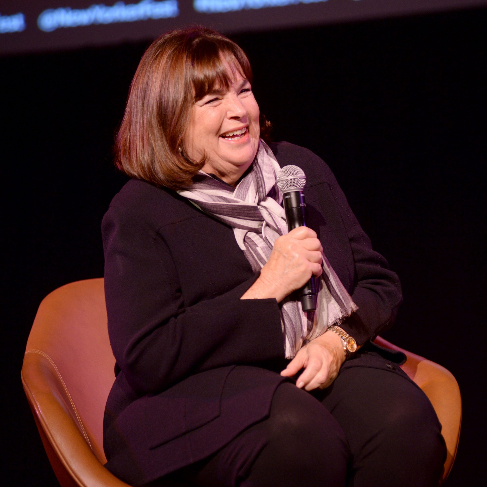 Ina Garten sitting in a chair