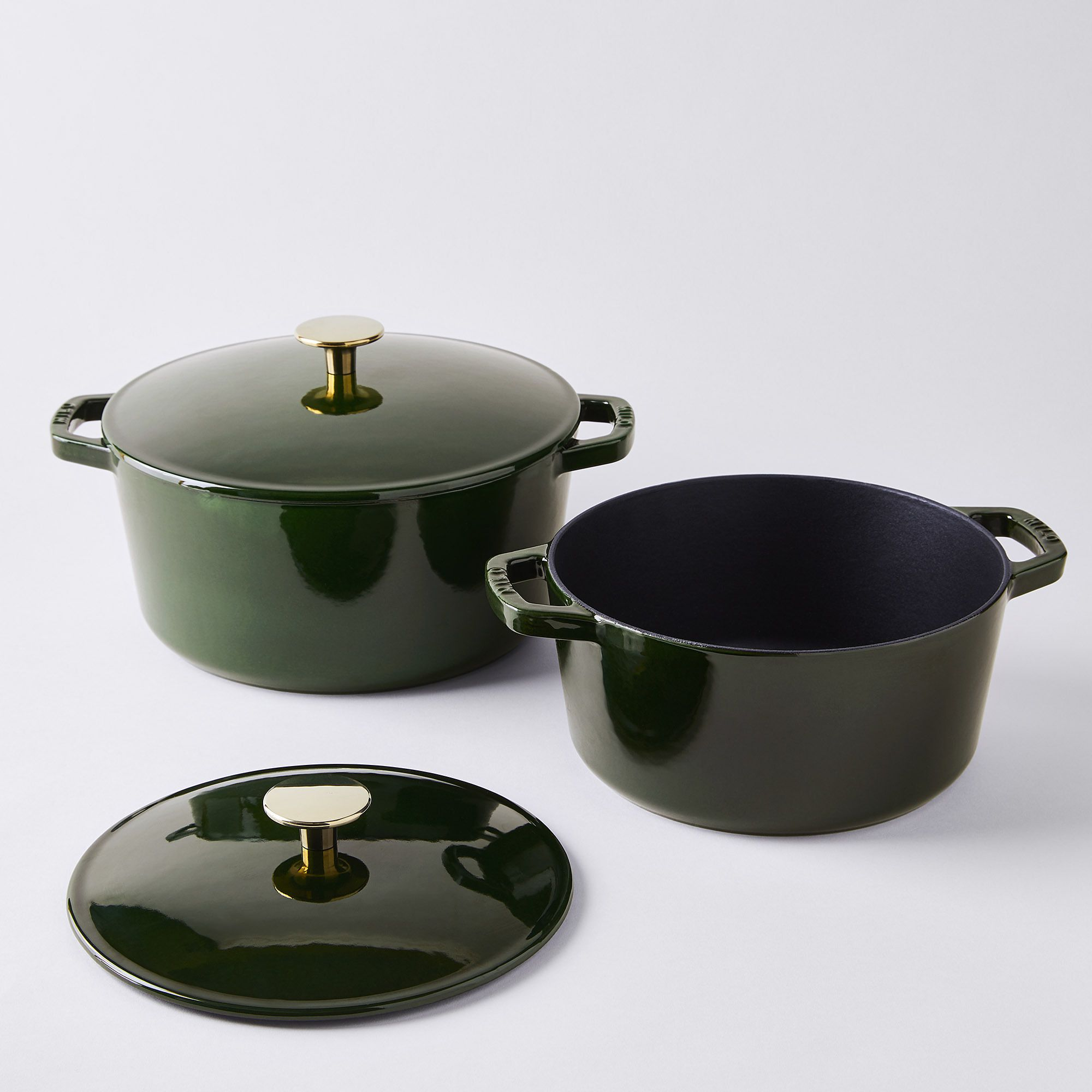 two green dutch ovens