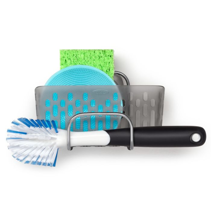 OXO scrub brush and sponge in a caddy