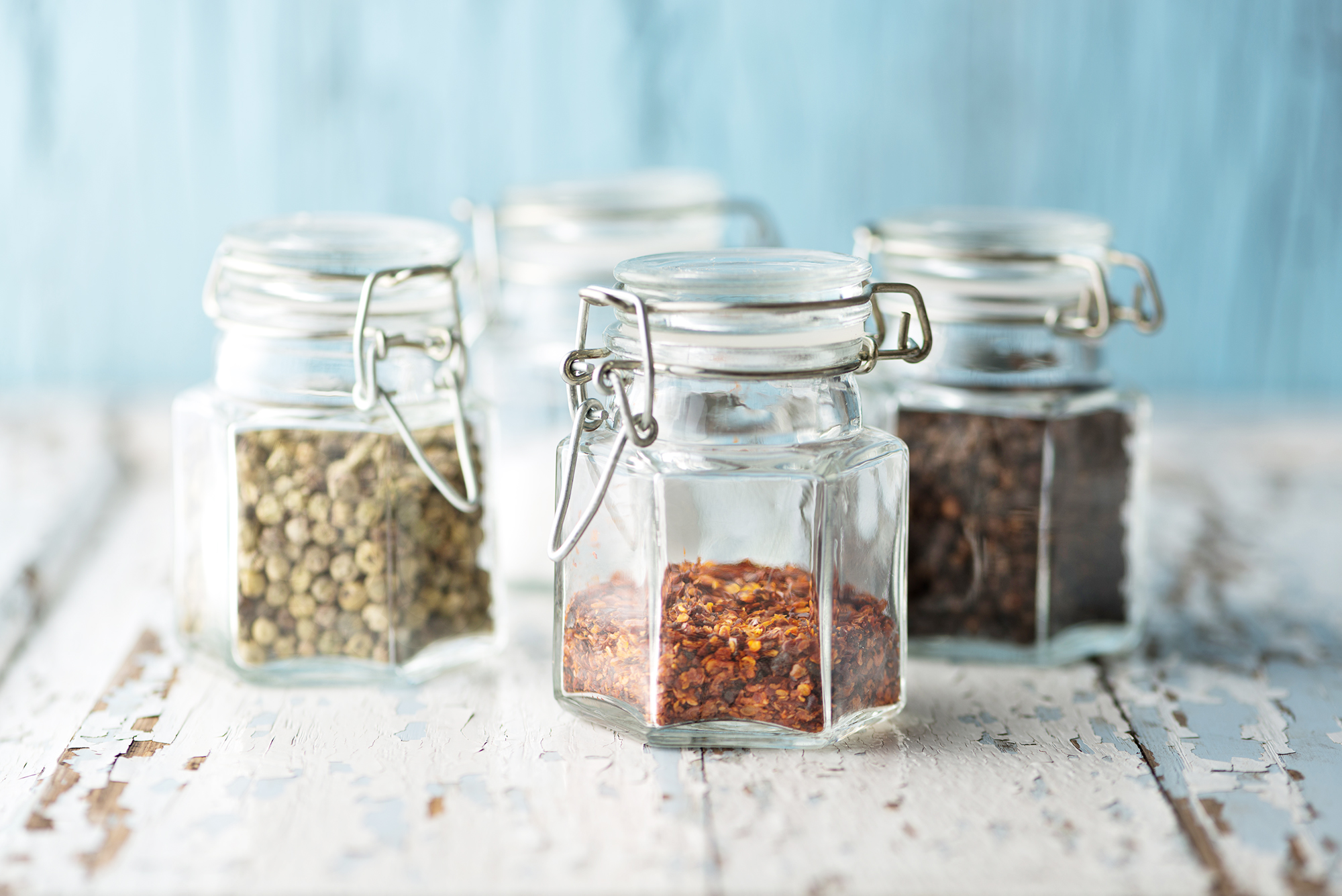 Glass jars with colorful pepper