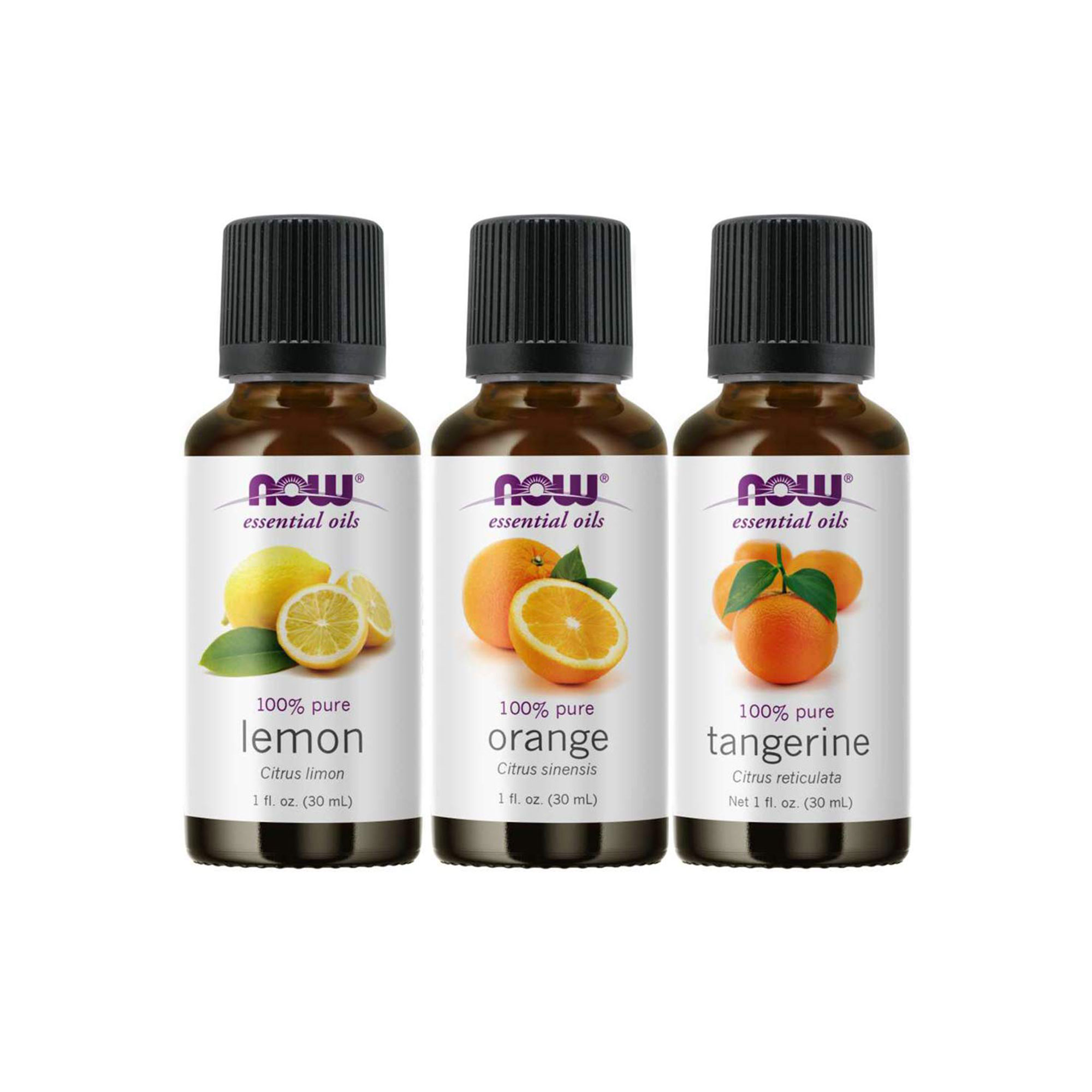 three bottles of essential oil on a white background