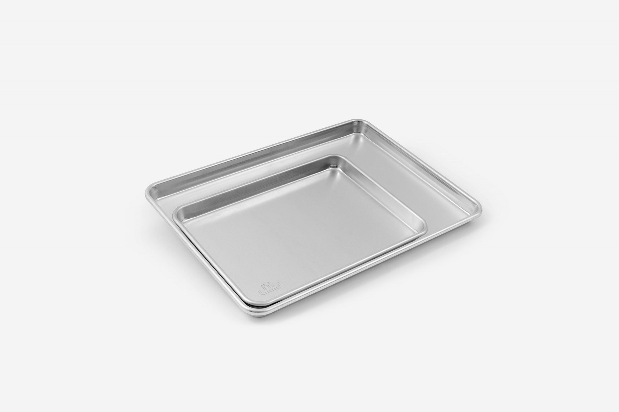 two sheet pans on a white background