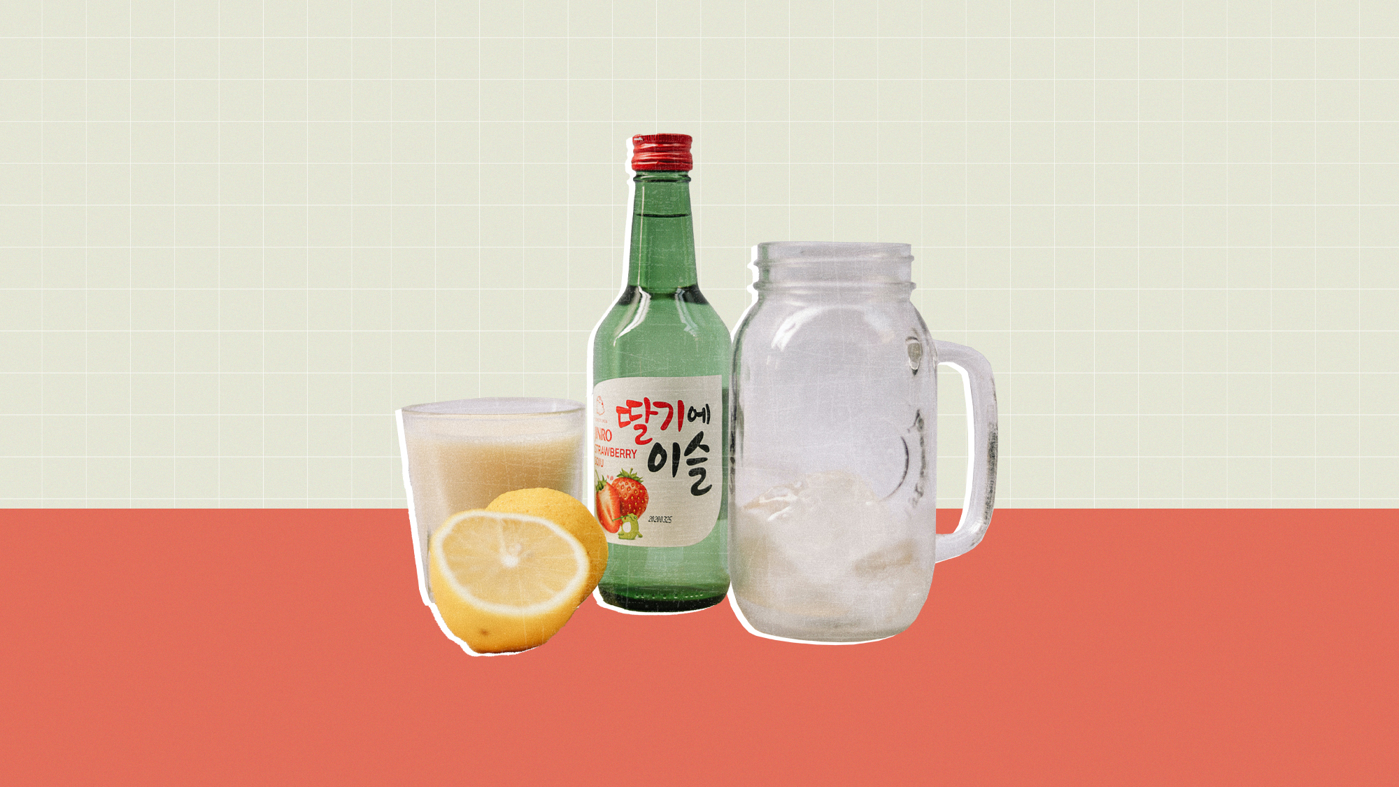 A bottle and glass of Soju with a sliced lemon