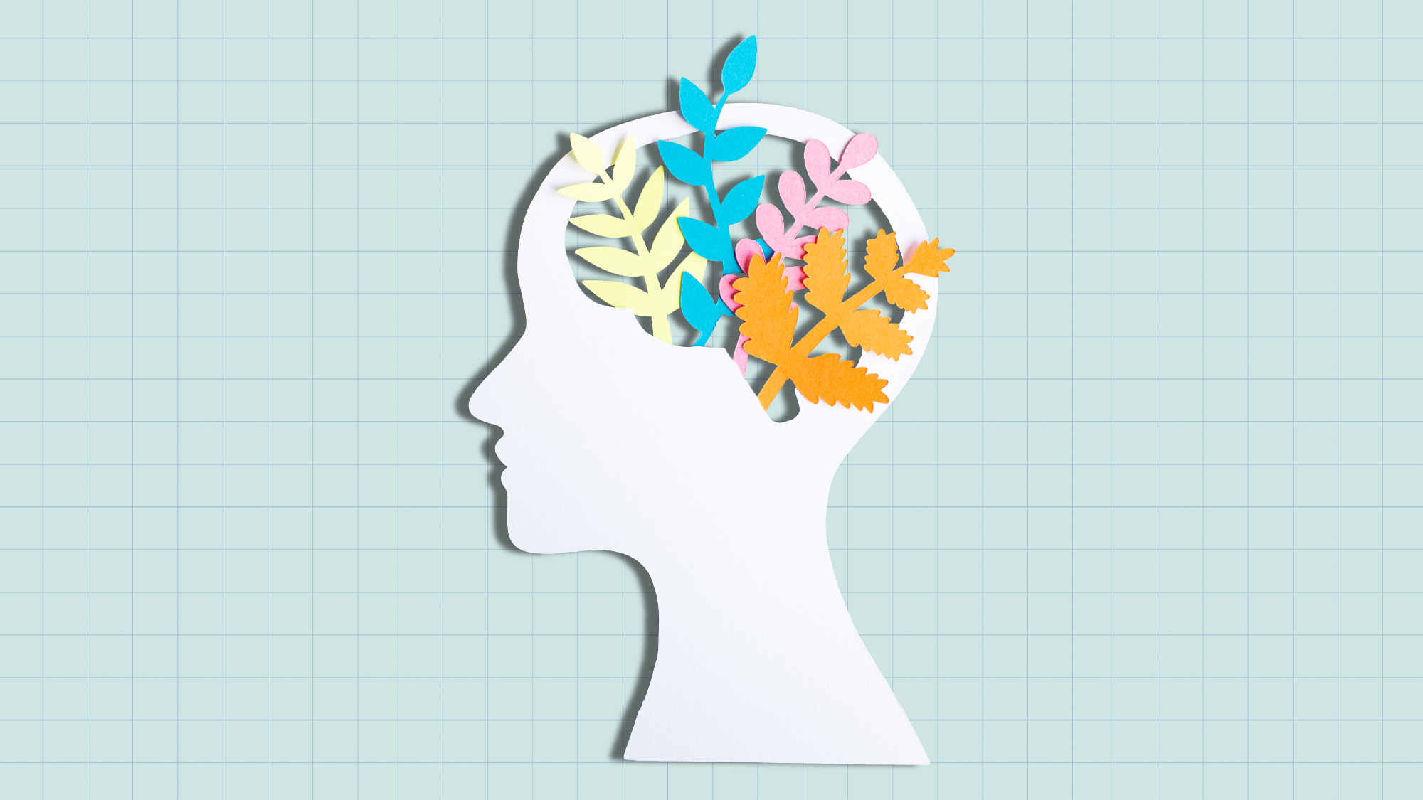 Cut out of head with plants growing on a designed background