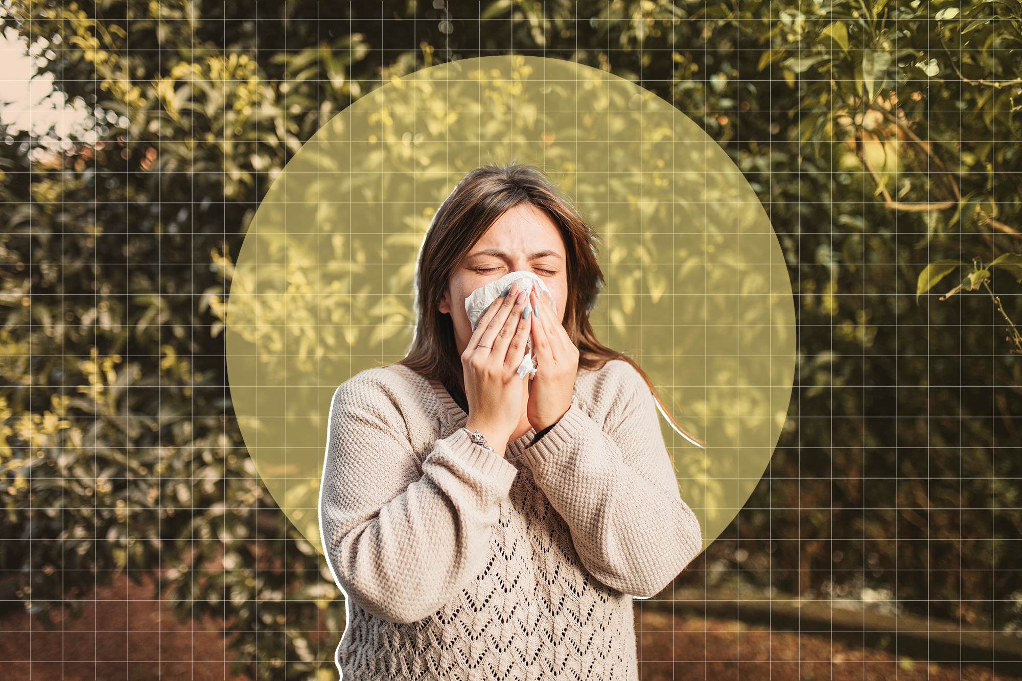 young woman suffering spring allergy and blowing nose with a tissue in the nature