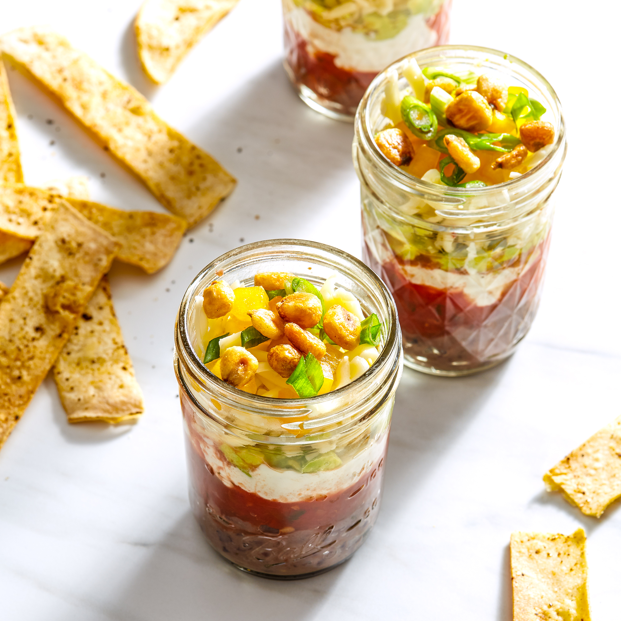 Individual Seven Layer Dip in Jars with Baked Tortilla Chips