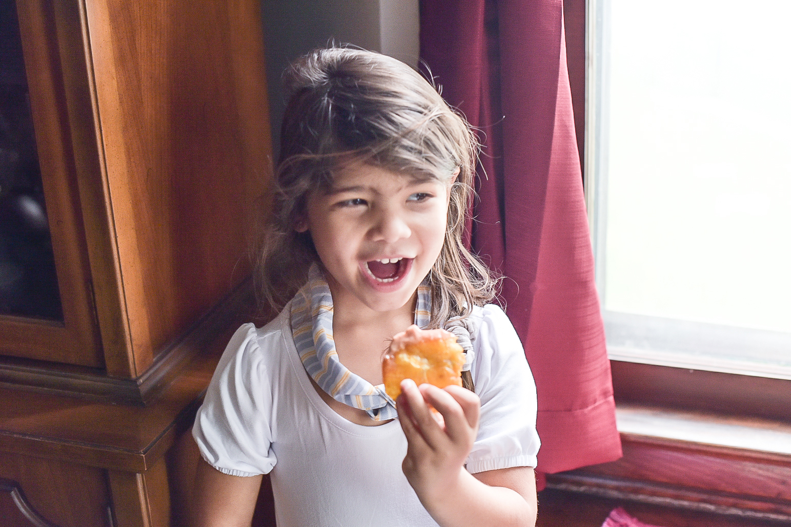 Portrait of a young girl eating tostones