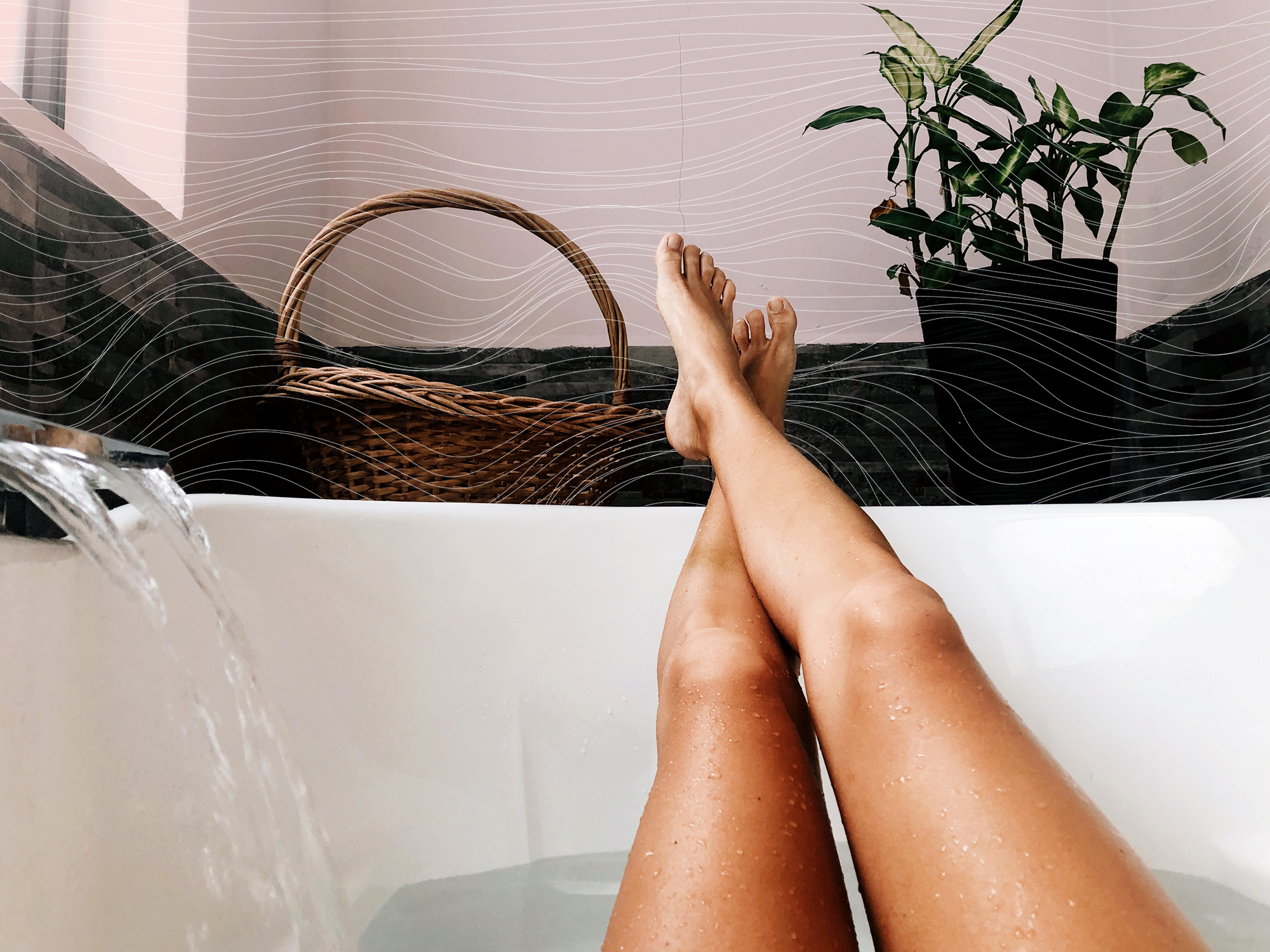 Woman Relaxing At Home In The Bathtub